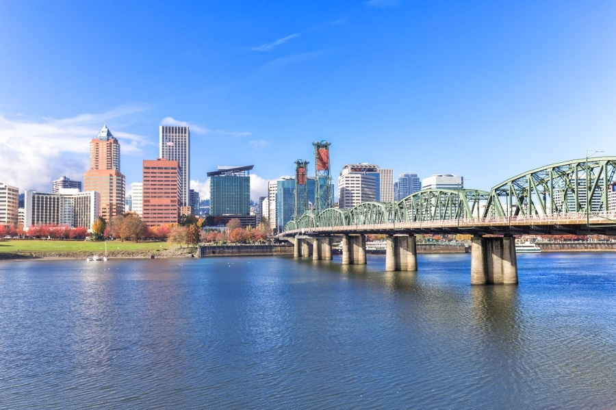 This is a picture of bridge going towards the city, Portland.