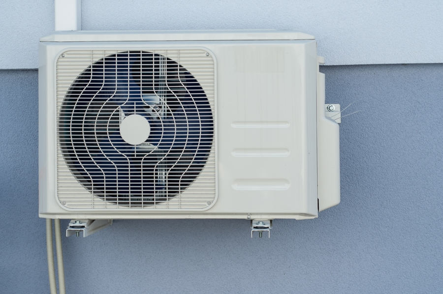 Cooling Fan Air Conditioner on blue wall background.