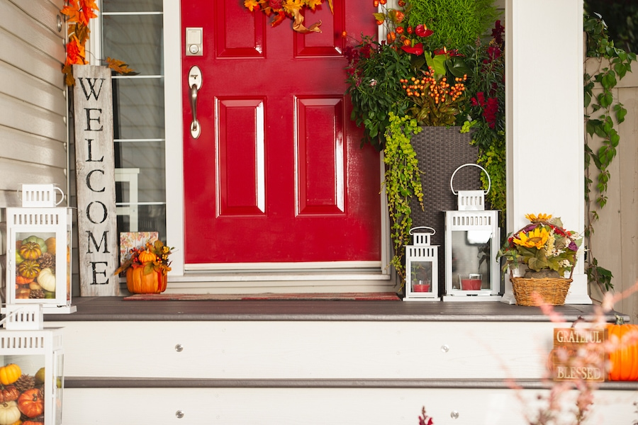 Outside of house decorated for Autumn after homeowner scheduled their fall HVAC maintenance appointment.