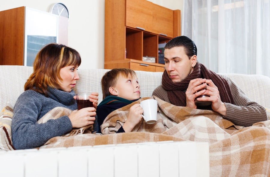 Cold family trying to stay warm and determining that it's time for a new furnace.