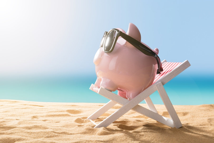 Piggy bank on the beach representing the financing options available for affording a new AC system and other HVAC equipment for your home.